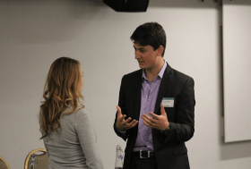 Lucas Hille chatting to a woman at an event